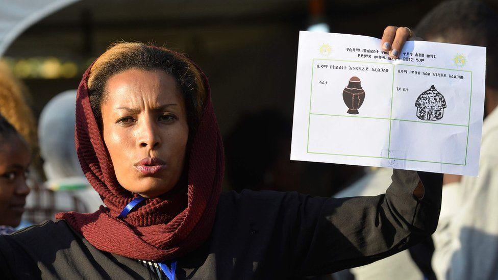 Woman showing ballot paper