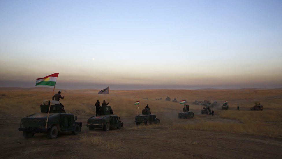 Monday, Oct. 17, 2016 file photo, a Peshmerga convoy drives towards a frontline in Khazer, about 30 kilometers (19 miles) east of Mosul, Iraq.