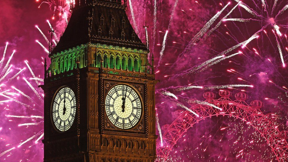 Fireworks explode around Big Ben in London to mark New Year celebrations