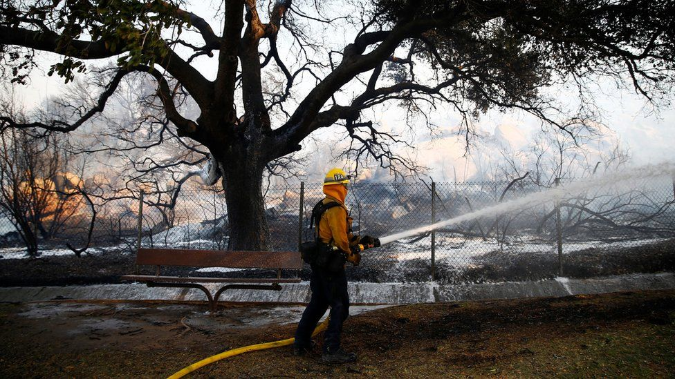 A firefighter battles the Peak fire in Simi Valley, California, 12 November