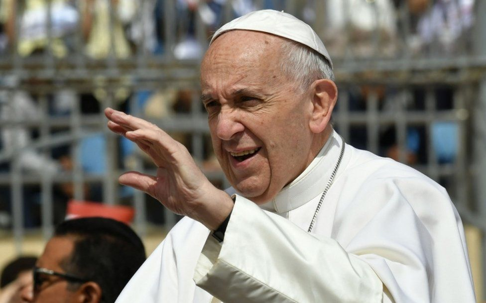 Pope Francis waves to worshippers before the start of a mass on April 29, 2017 at a stadium in Cairo.