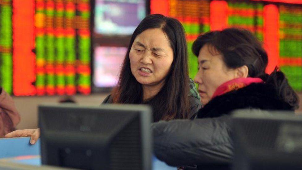 Investors looking at share screen