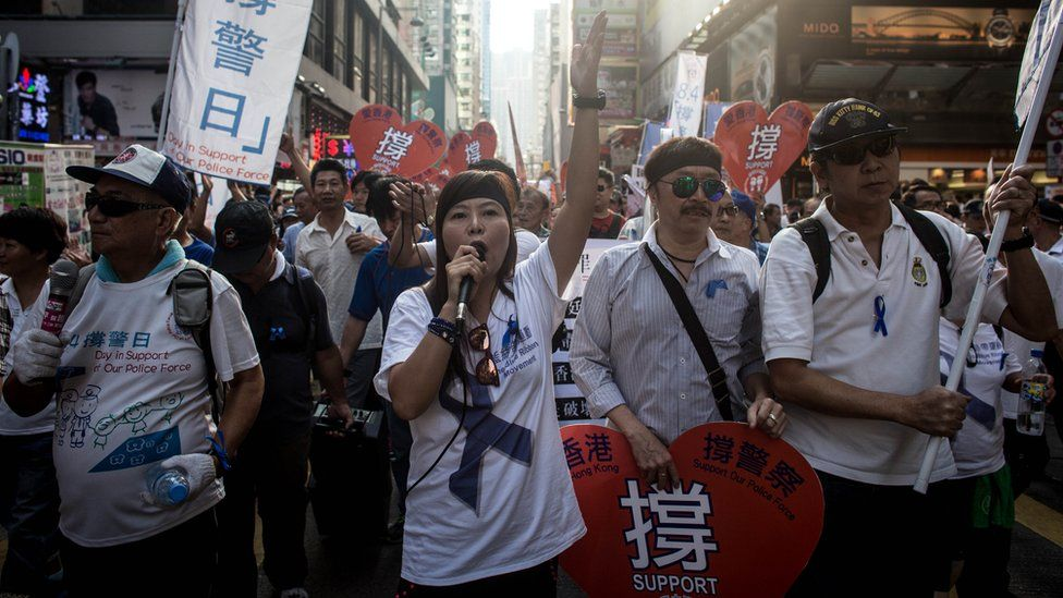 Members of the pro-government Blue Ribbon group march through the streets of Mong Kok to protest the lack of police action against pro-democracy activists on October 12, 2014 in Hong Kong