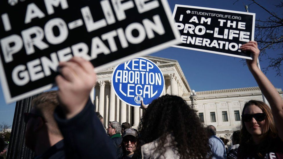 Anti-abortion and pro-choice placards