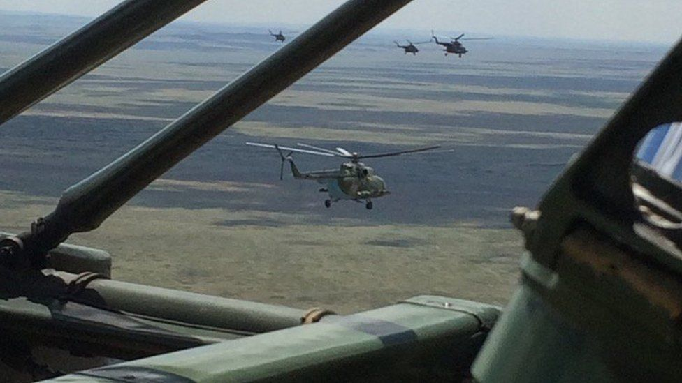 Helicopters flying to Soyuz landing zone