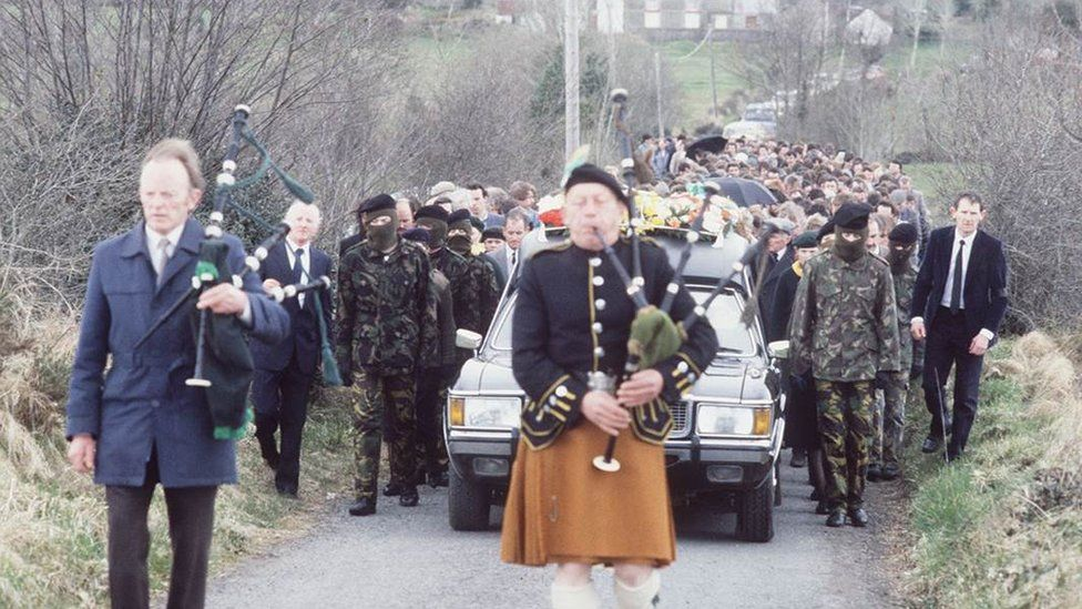 A piper leads the funeral for Seamus McElwaine