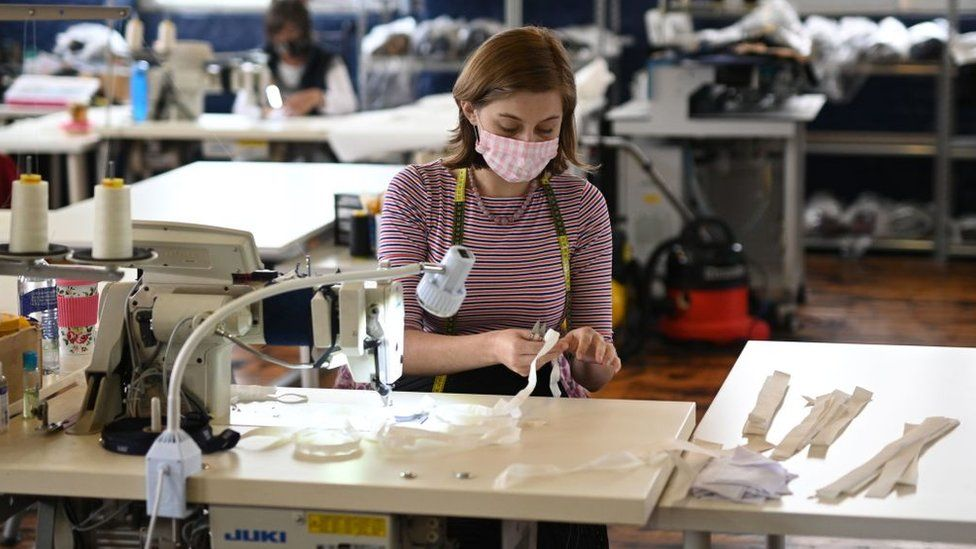 A female factory worker at a sewing machine