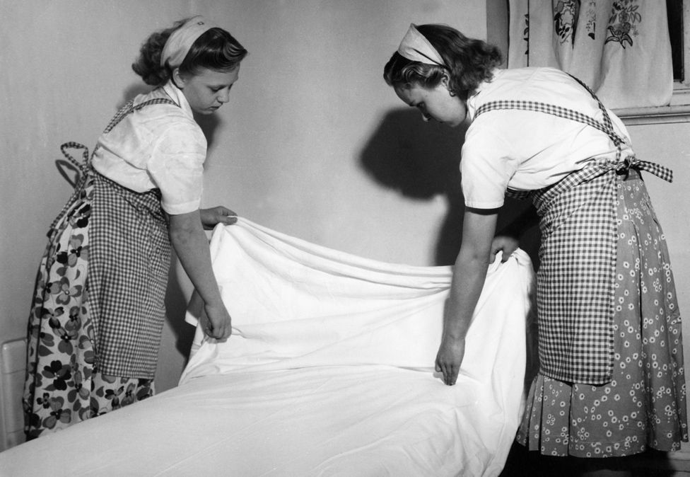 Schoolgirls making bed Great Britain 1950s
