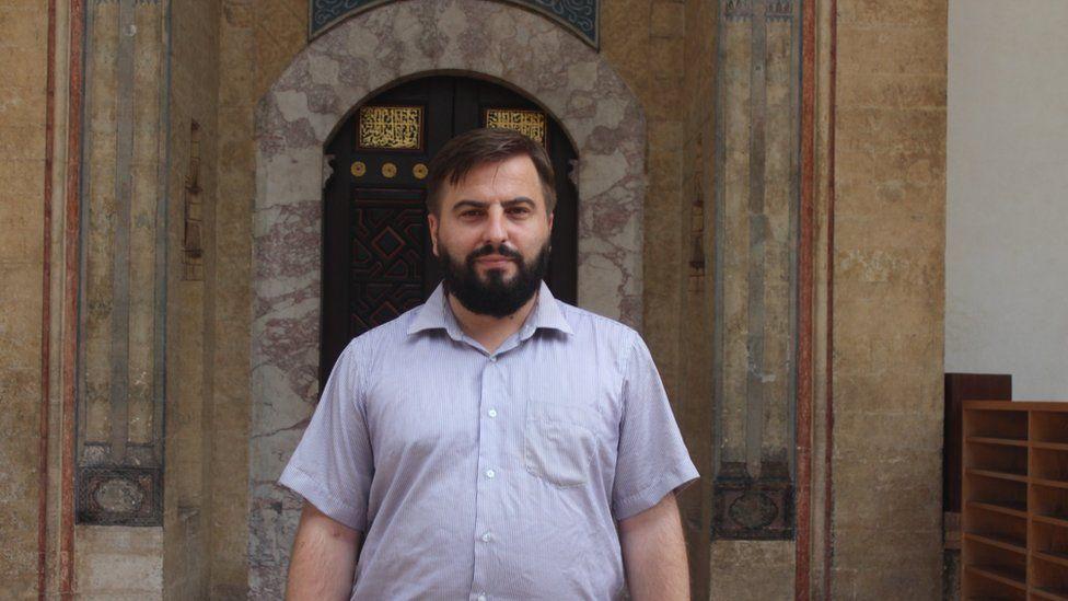 Adnan Ducic in front of the 16th century Gazi Husrev-bey Mosque in Sarajevo