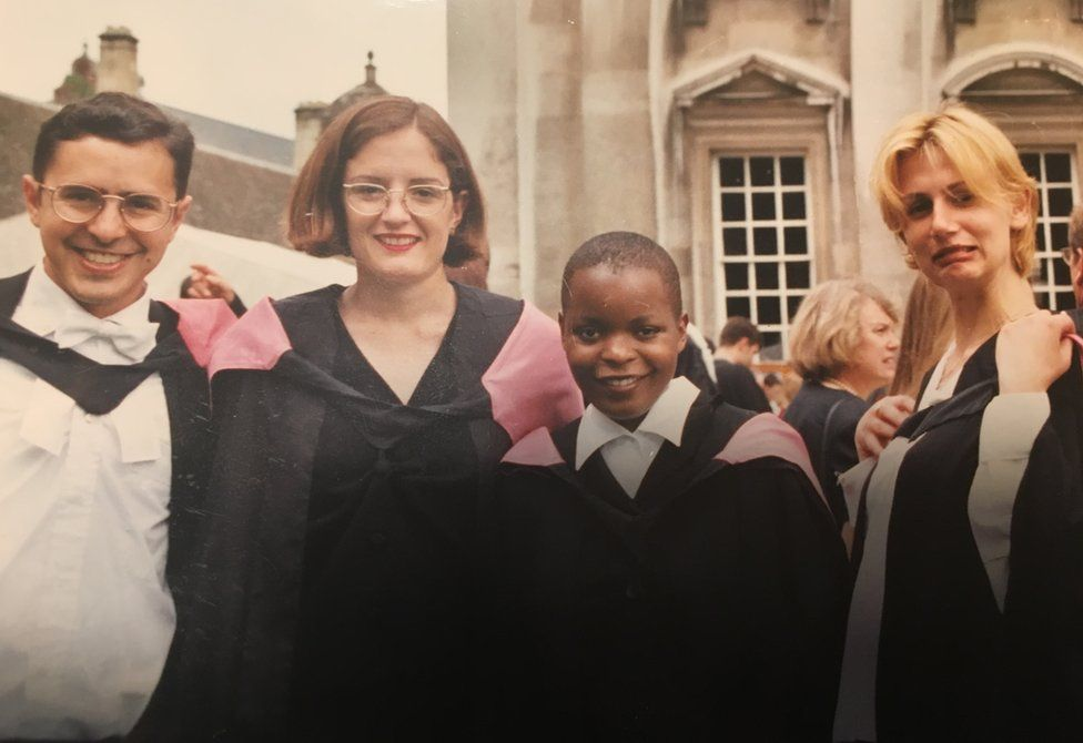 The author with friends on graduation day at the University of Cambridge in the UK