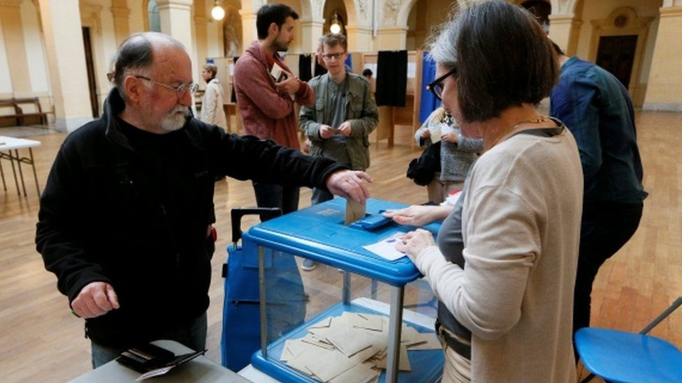A man votes in the second round of 2017 French presidential election at a polling station in Lyon, France, May 7, 2017.