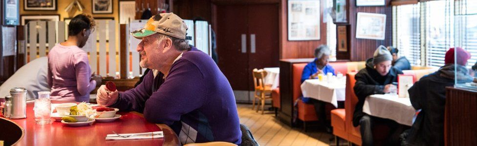 A man eats at the bar of Junior's restaurant, a staple of Brooklyn dining since the 1950s, on February 21, 2014