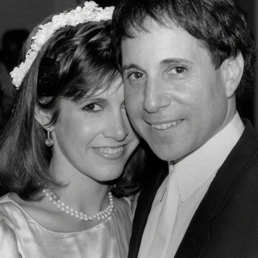 Carrie Fisher and Paul Simon pictured in 1983