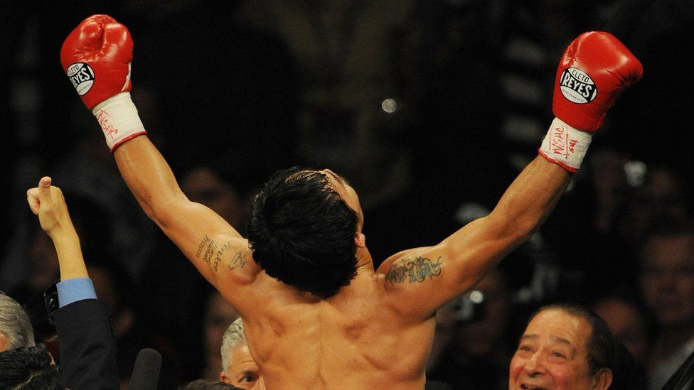 Manny Pacquiao of the Philippines celebrates after knocking out Ricky Hatton of England to win their Welterweight title fight at the MGM Grand Garden Arena on 2 May 2009 in Las Vegas