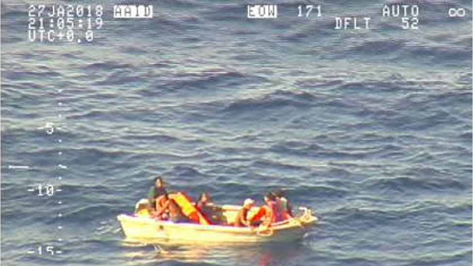 Small dinghy carrying seven people
