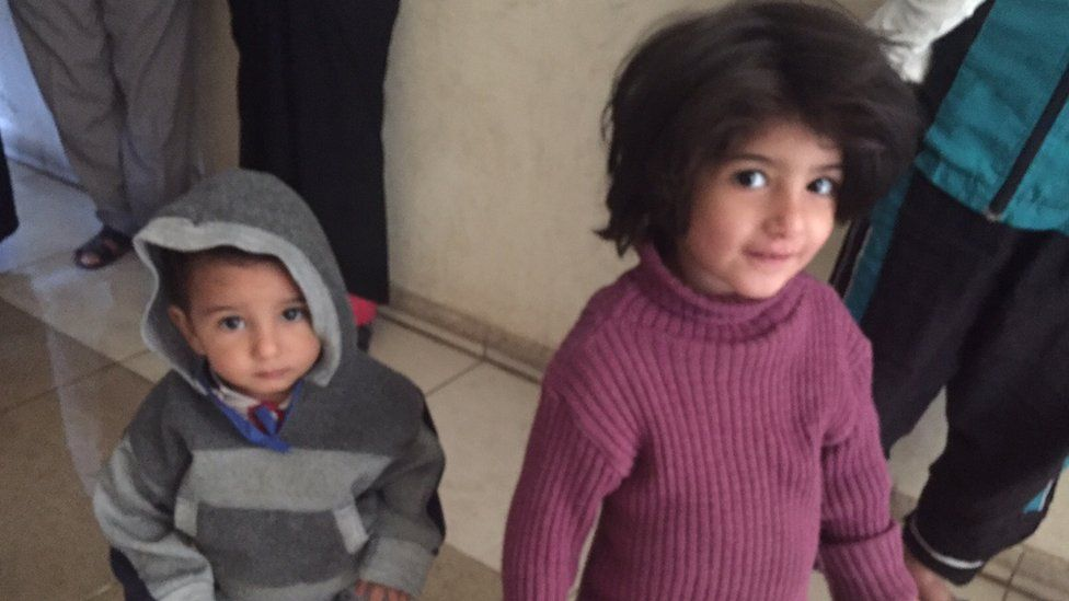 Two children from a displaced family