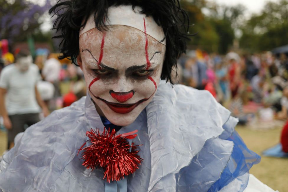 A child wears a costume during the annual Halloween party at the George Hay Park in Johannesburg, South Africa, 31 October 2018. Hundreds of local residents gather at the park in the evening to dress up, trick-or-treat and have a best dressed competition. Halloween has its roots in an ancient, pre-Christina Celtic festival named Samhain. The Celts lived 2,000 years ago and believed that the dead returned to Earth on the Samhain festival.