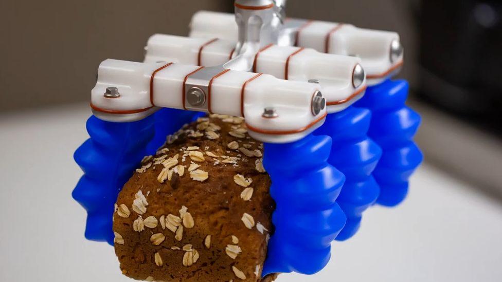 Soft Robotics gripper holding cake