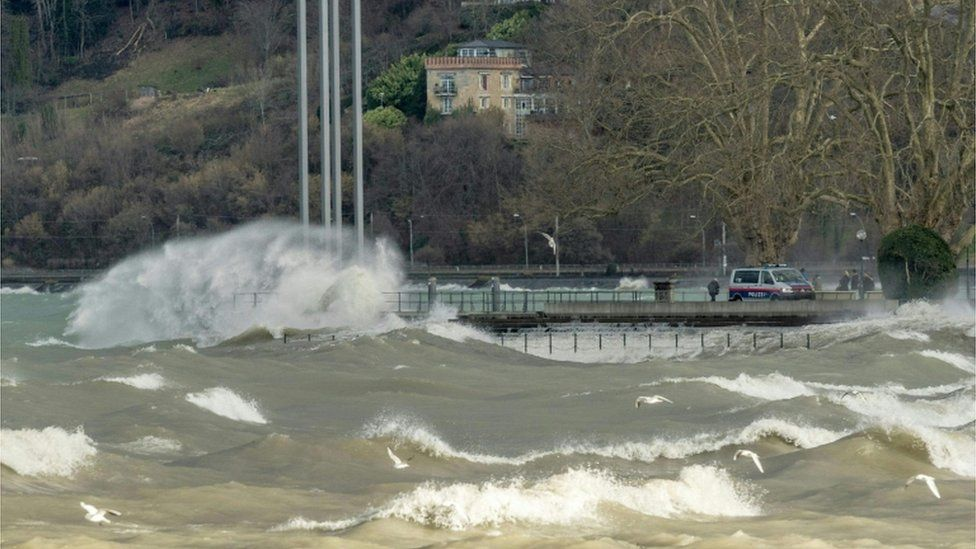 Waves crash into a quay on Lake Constance in Austria