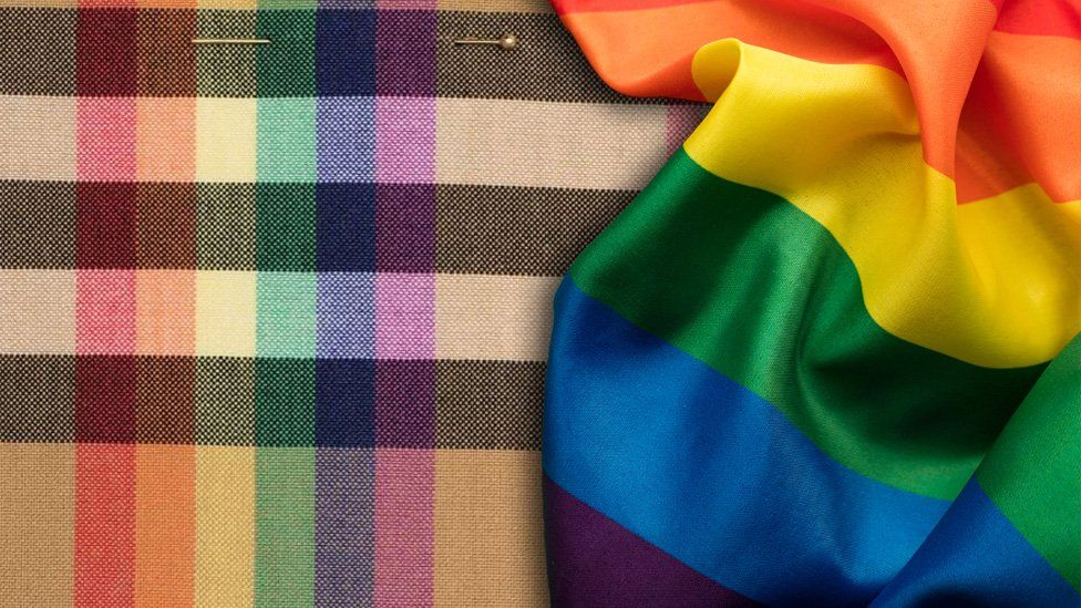The new Burberry rainbow scarf next to the LGBT flag