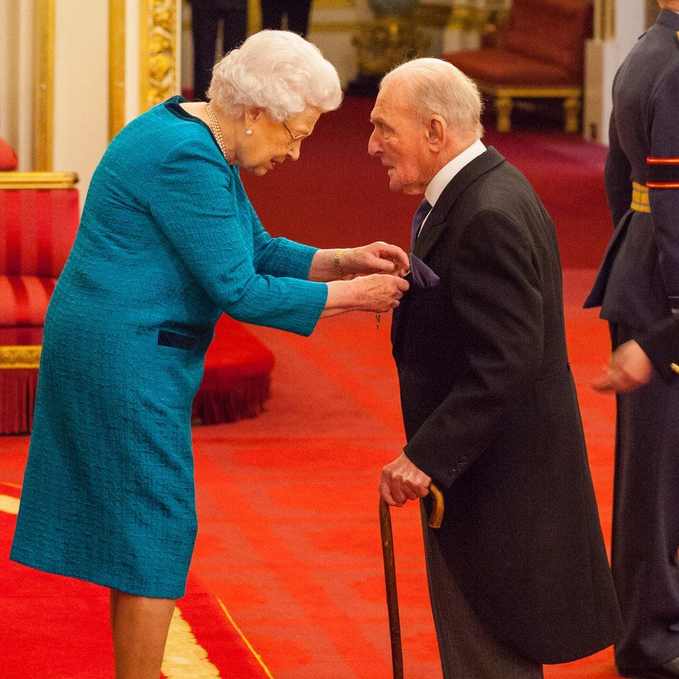 """The Queen presents George """"Johnny"""" Johnson with his MBE"""