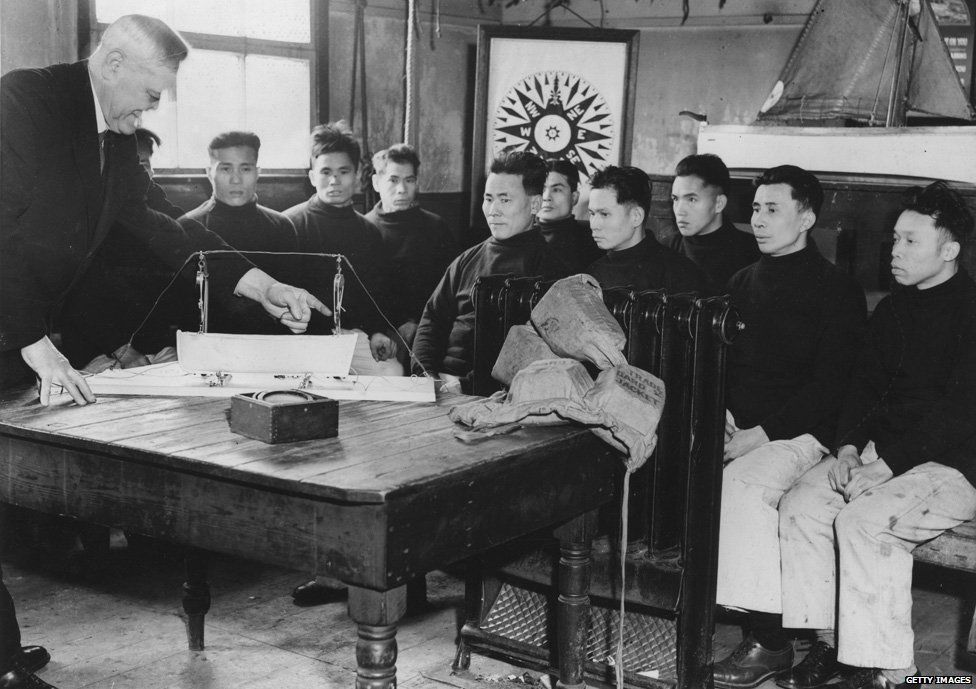 22nd February 1938: Chinese seamen receiving theoretical instruction in the launching of a boat from a ship's deck, as they attend the naval training school at Salthouse Dock in Liverpool