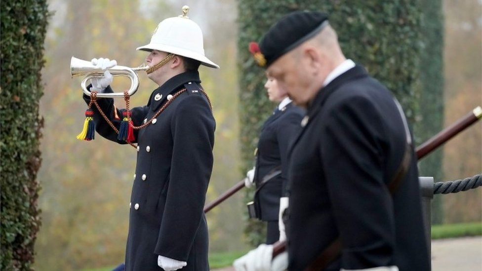 Dignitaries gather to pay respect to service members who fought in the two World Wars and subsequent conflicts at the National Memorial Arboretum amid the coronavirus pandemic in Stafford, Britain November 8, 202
