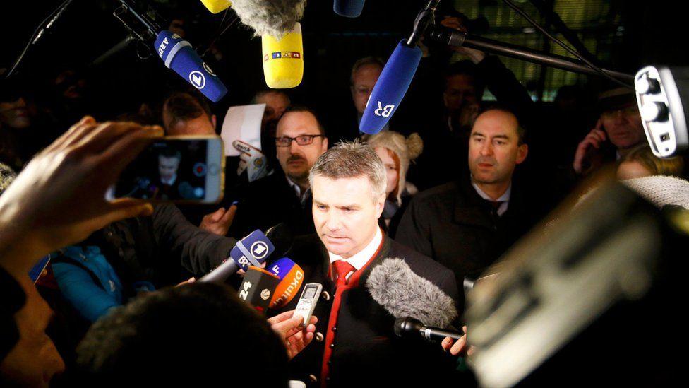 Landshut mayor Peter Dreier speaking to media outside Chancellor Merkel's office (14 January)