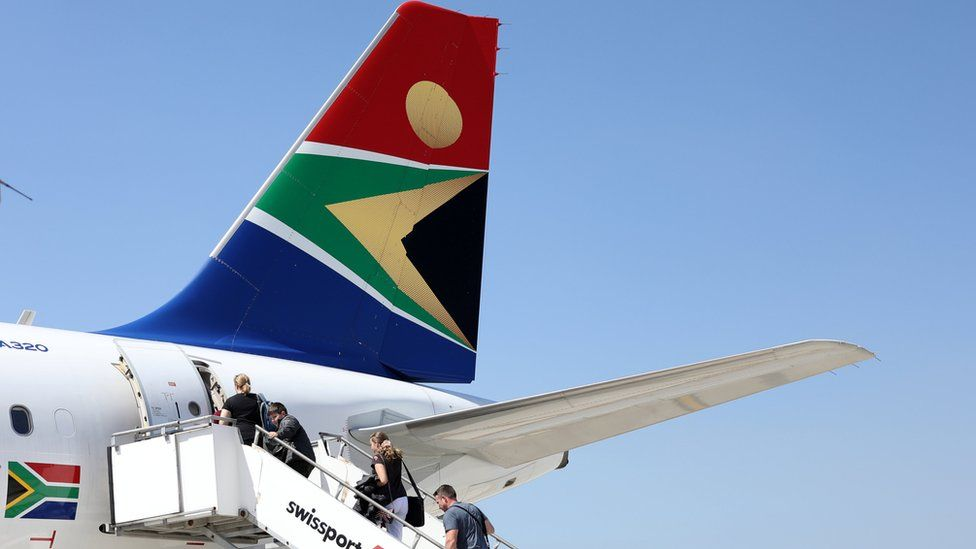 Passengers board a South African Airways plane at the Port Elizabeth International Airport in the Eastern Cape province, South Africa, September 30, 2018.