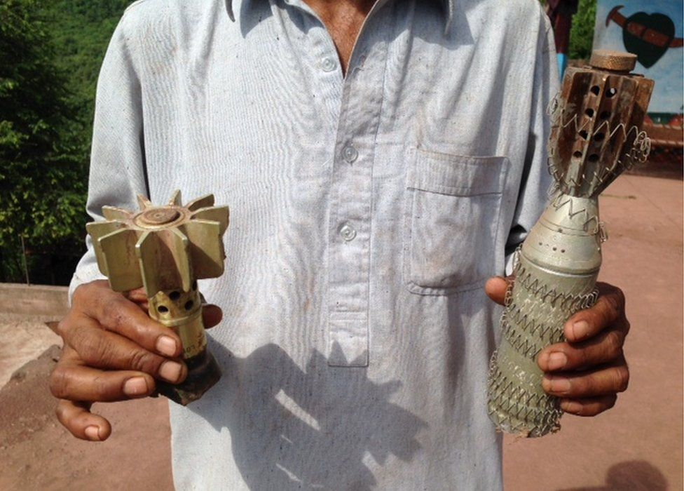 Javed Ahmed shows the BBC mortar shells and ammunition he collected in Pakistan administered Kashmir, August 2015