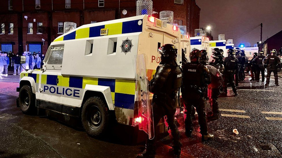 PSNI officers and Land Rovers on the nationalist side of the Springfield Road in Belfast after dispersing people from the area, following further unrest. Picture date: Wednesday April 7, 2021