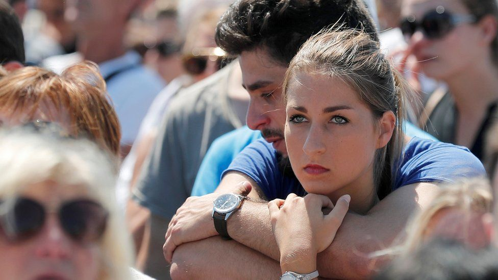 People observe the minute's silence on the Promenade des Anglais in Nice, southern France, 18 July