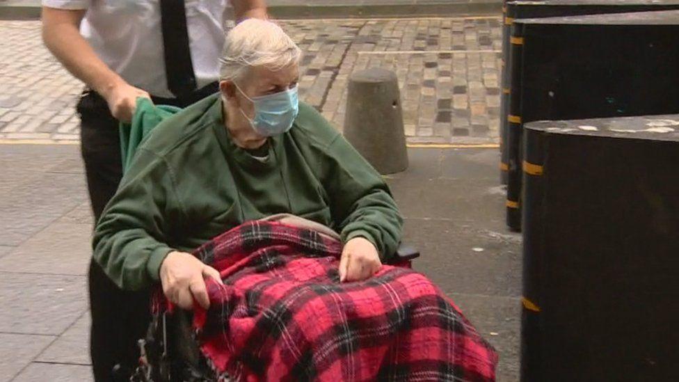 "Fr Denis ""Chrysostom"" Alexander arrived at court in a wheelchair"