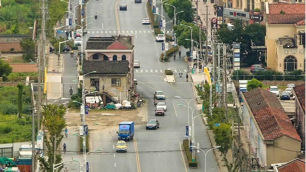 Shanghai house in the middle of a wide road