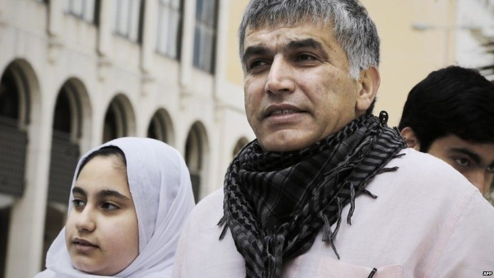 Bahraini human rights activist Nabeel Rajab and his daughter Malak (left) leave a court after attending his appeal hearing (11 February 2015)