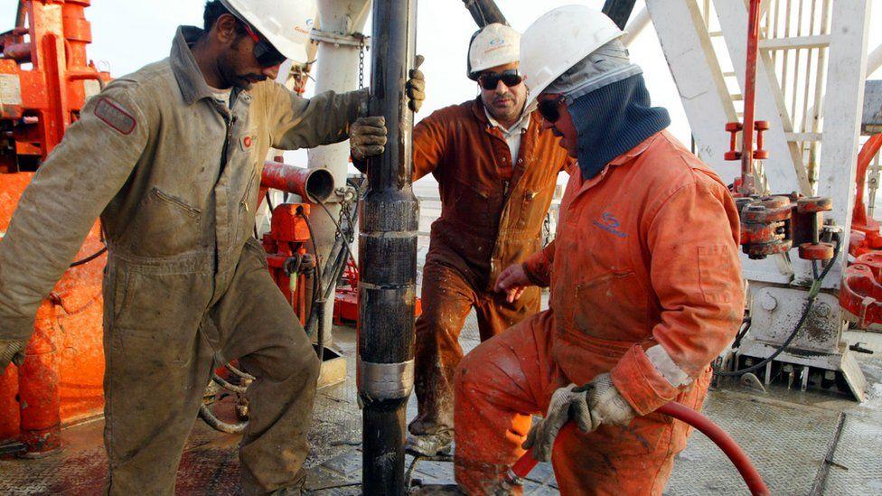 Oil workers in Kuwait