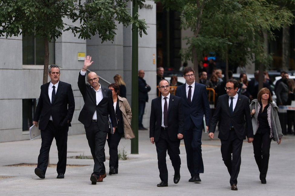 Dismissed Catalan Foreign Affairs chief Raul Romeva waves as he arrives with other dismissed cabinet members at Spain's High Court after being summoned to testify on charges of rebellion, sedition and misuse of public funds for defying the central government by holding a referendum on secession and proclaiming independence, in Madrid, Spain, November 2, 2017.