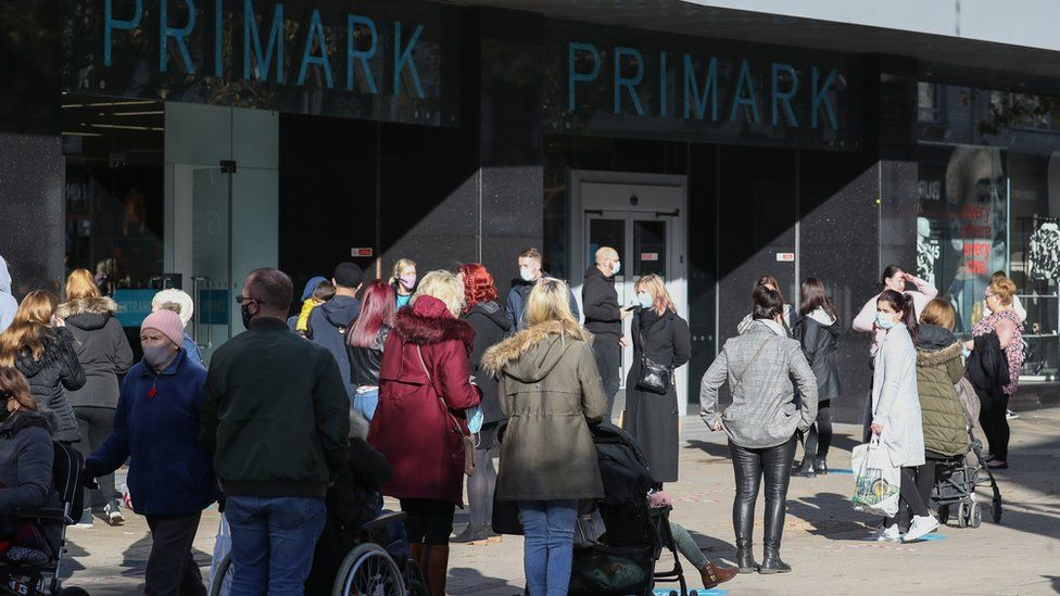 Shoppers queue outside Primark in Portsmouth