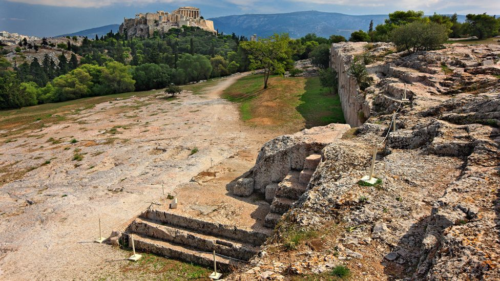 """The """"Bema"""" or """"Vema"""" of Pnyx, where popular assemblies took place in Ancient Athens, Greece (looking across to the Acropolis)"""