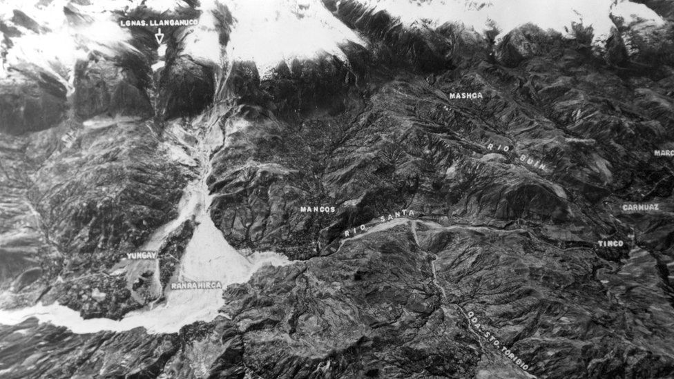 Aerial view showing the mountain range and the towns it buried