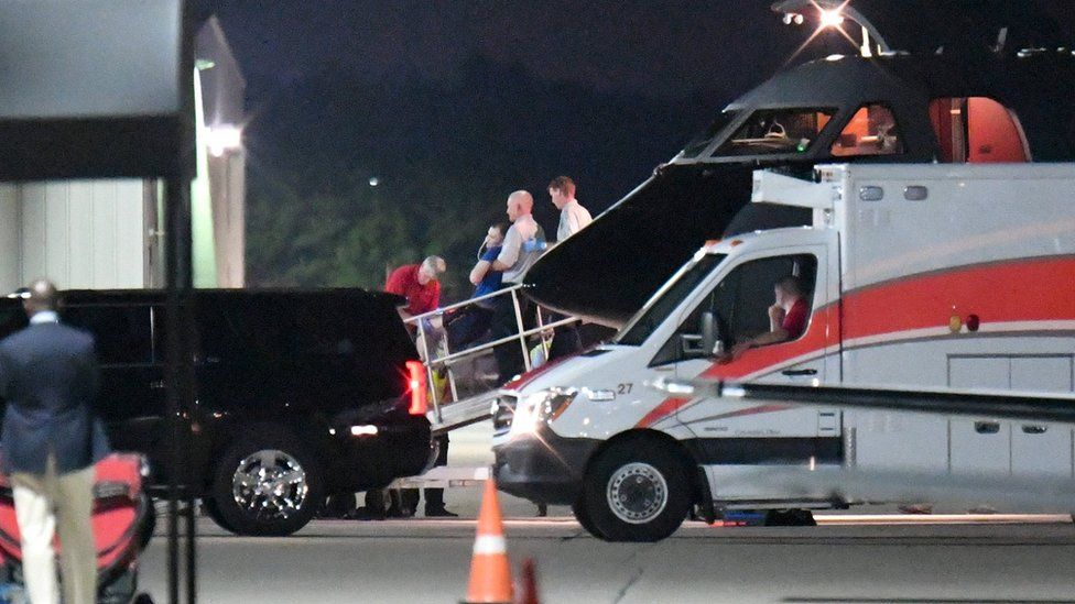 A person believed to be Otto Warmbier is transferred from a medical transport airplane to an awaiting ambulance at Lunken Airport in Cincinnati, Ohio, U.S., June 13, 201