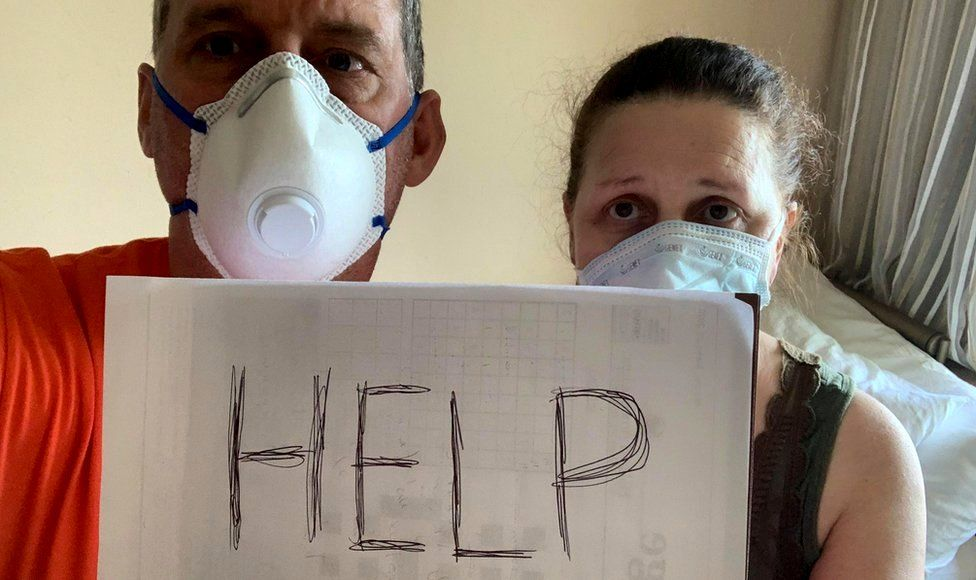 Canadian passengers Chris and Anna Joiner ask for help on board the MS Zaandam, Holland America Line cruise ship, during the coronavirus outbreak, off the shores of Panama City, Panama, 27 March 2020