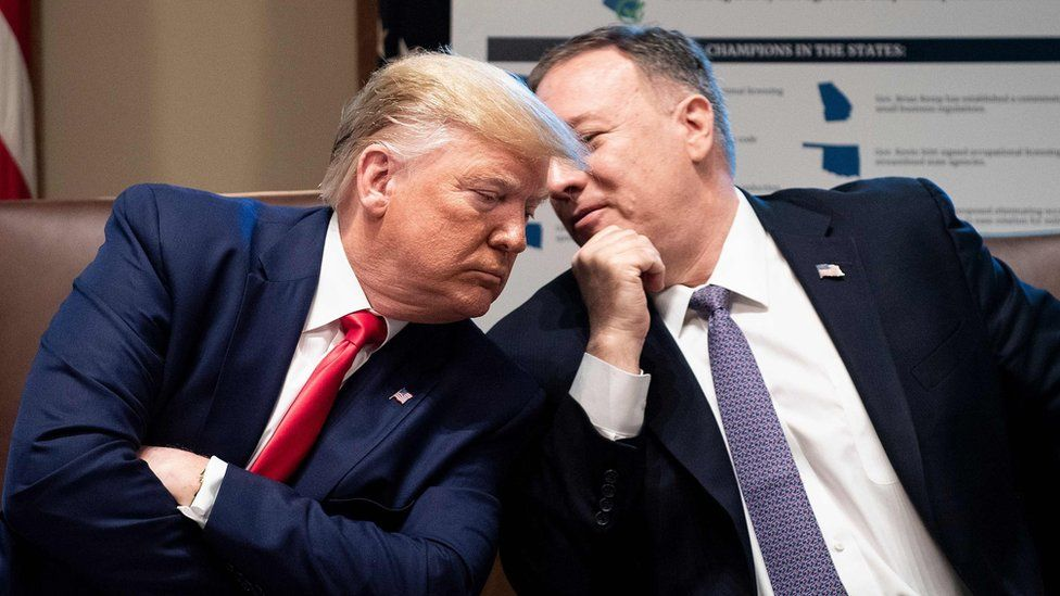 US President Donald Trump listens to US Secretary of State Mike Pompeo during a cabinet meeting at the White House