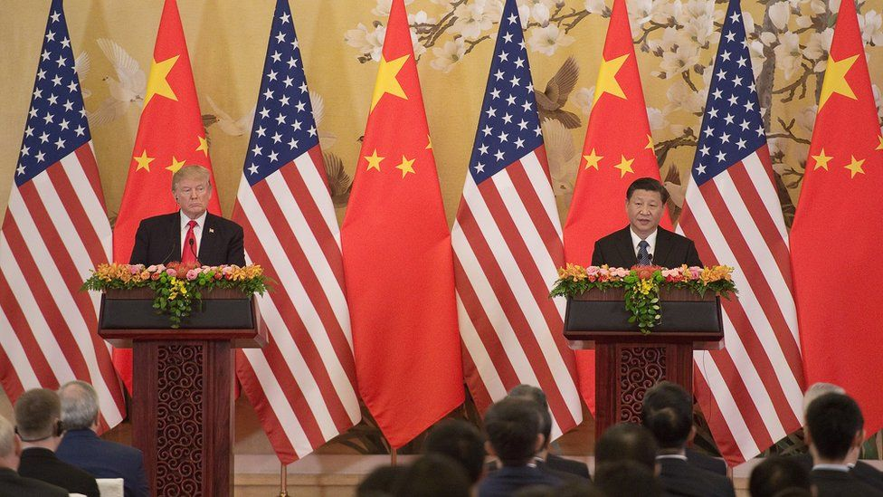 US President Donald Trump (L) and China's President Xi Jinping speak during a joint statement in Beijing on November 9, 2017.