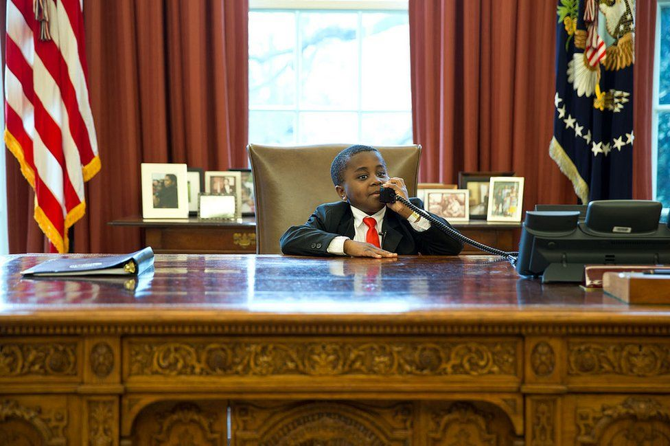 Kid President feigns a phone call in the Oval Office