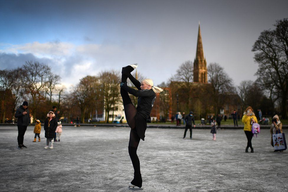 Skater Suzie Murray skates a Queens Park pond in Glasgow, Scotland.