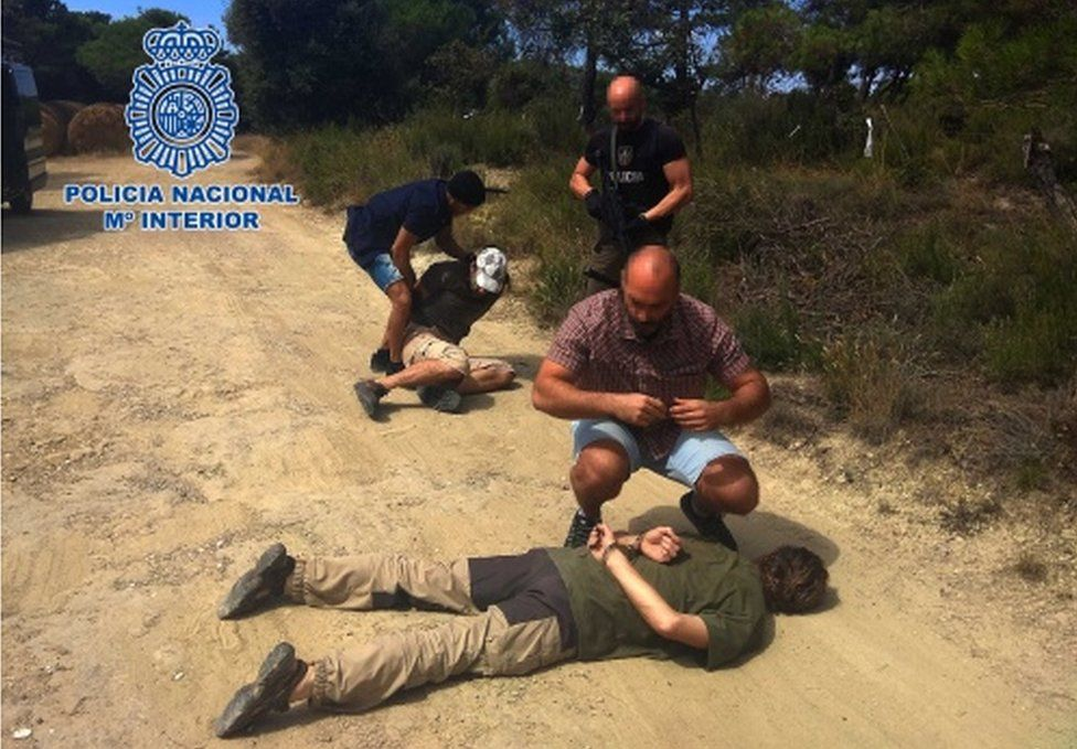 A Spanish police handout photo showing Jos Brech lying on a dirt road in handcuffs