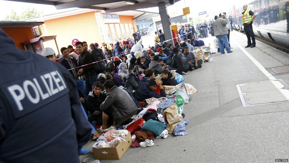 Migrants at a border train station in Germany