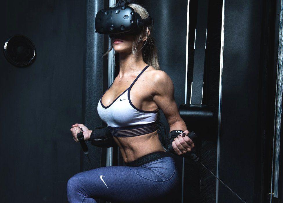 Woman using VR gym kit