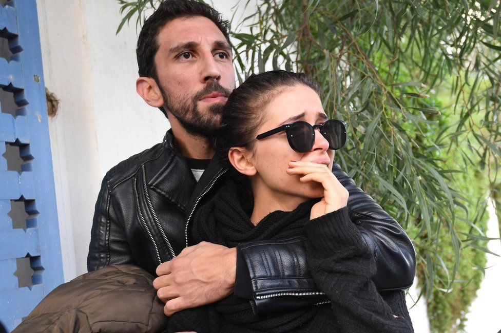 Mourners attend the funeral of the late Tunisian fashion designer Azzedine Alaia, who died this month aged 77, in the Sidi Bou Said cemetary in the capital Tunis on November 20, 2017.